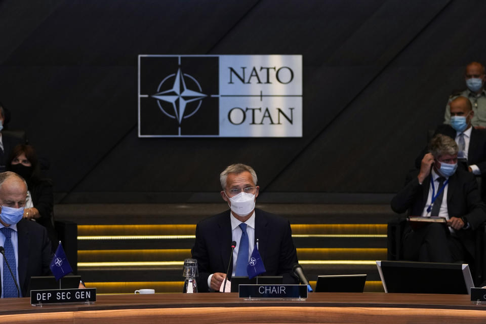 NATO Secretary General Jens Stoltenberg, center, speaks during a NATO Foreign Ministers video meeting following developments in Afghanistan at the NATO headquarters in Brussels, Friday, Aug. 20, 2021. (AP Photo/Francisco Seco, Pool)