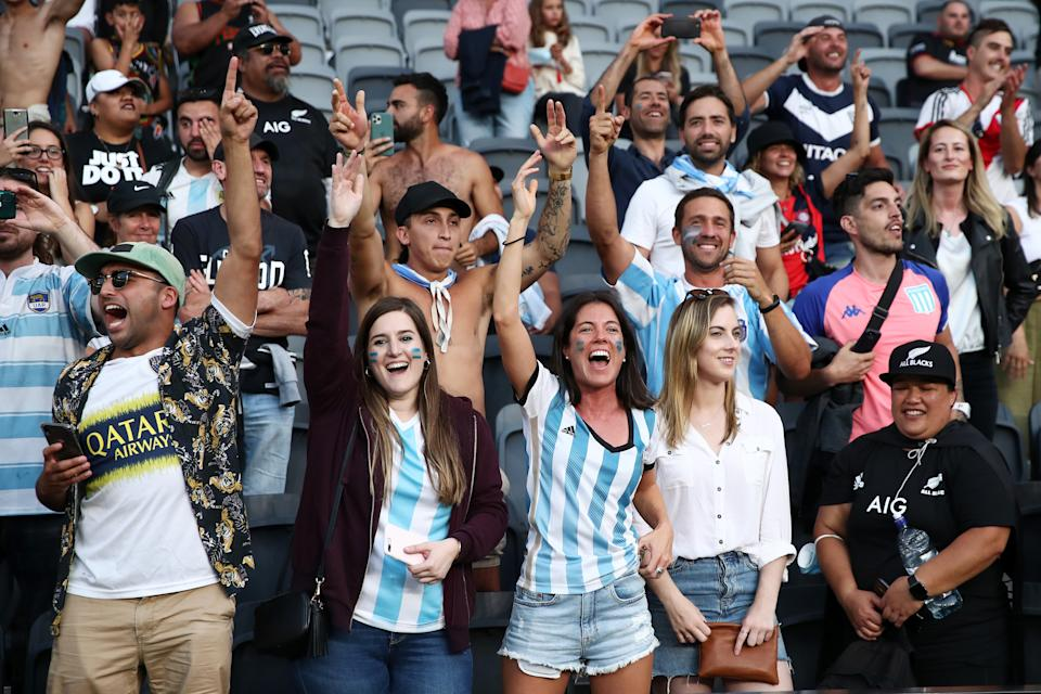 Argentina fans celebrate winning the 2020 Tri-Nations rugby match between the New Zealand All Blacks and the Argentina Los Pumas.