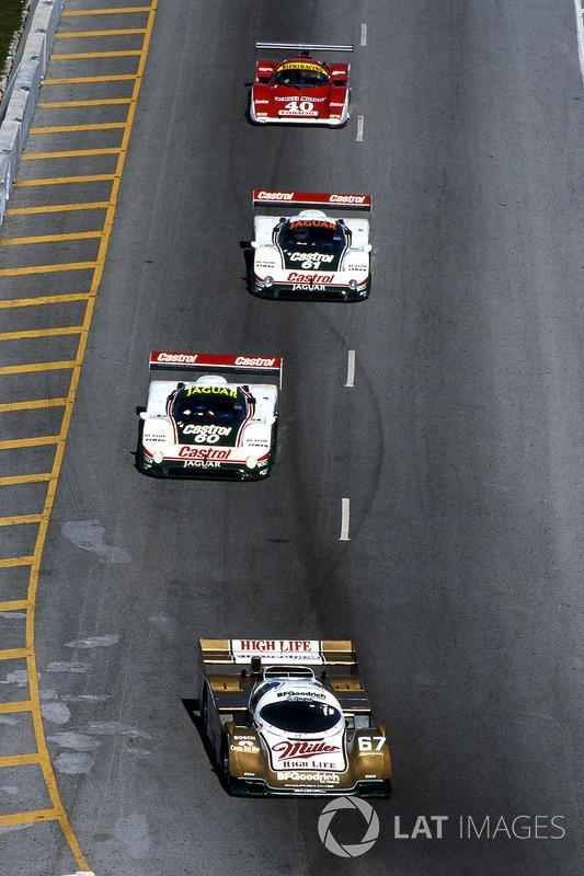 """John Andretti, Bob Wollek and Derek Bell head to Daytona 24 Hours victory in 1989 driving a Porsche 962. <span class=""""copyright"""">Sutton Images</span>"""