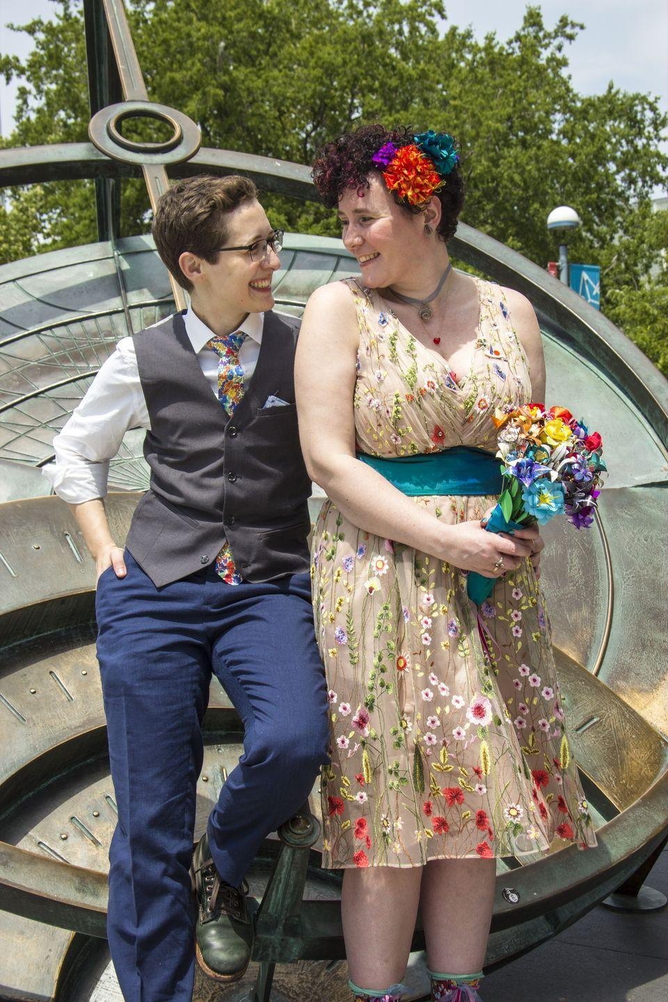 """<p>In June 2017, Jay and Tea invited their families to join them at the Hall of Science in Flushing, Queens where they exchanged vows under the Titan II. The flowers in Tea's hair were made out of the letters they wrote each other during their <a href=""""https://www.oprahdaily.com/life/relationships-love/a27628635/long-distance-relationship-tips/"""" rel=""""nofollow noopener"""" target=""""_blank"""" data-ylk=""""slk:long-distance relationship"""" class=""""link rapid-noclick-resp"""">long-distance relationship</a>.</p>"""