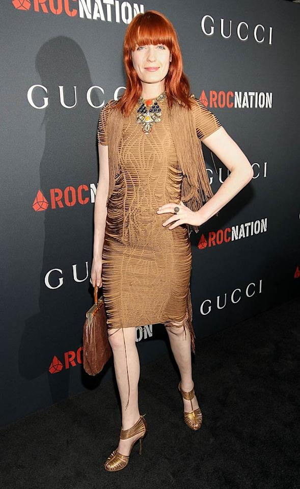 """Florence Welch of Florence + the Machine fame paired her stringy frock with metallic strappy heels. A colorful statement necklace and fiery red locks topped off her interesting look. Christopher Polk/<a href=""""http://www.gettyimages.com/"""" target=""""new"""">GettyImages.com</a> - February 12, 2011"""