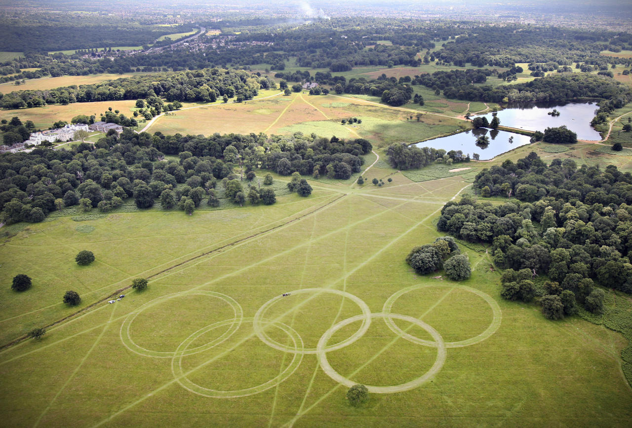 In this handout image released by LOCOG on July 9, 2012, an aerial view of Olympic Rings cut into the grass of Richmond Park, London, England. The rings, which are approximately 300 metres wide and over 135 metres tall, are visible on the Heathrow flight path, ready to welcome athletes and visitors to the London 2012 Olympic Games. The five rings represent the five continents and the meeting of athletes from throughout the world at the Olympic Games. (Photo by David Poultney for LOCOG via Getty Images)