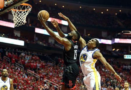 May 24, 2018; Houston, TX, USA; Houston Rockets guard James Harden (13) drives around Golden State Warriors forward Kevon Looney (5) during the second quarter in game five of the Western conference finals of the 2018 NBA Playoffs at Toyota Center. Mandatory Credit: Troy Taormina-USA TODAY Sports