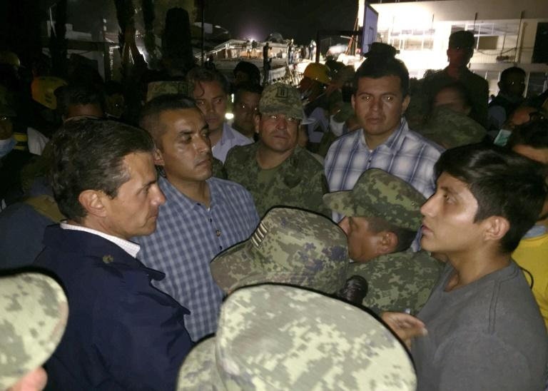 Mexican President Enrique Pena Nieto, who visited rescuers at the Rebsamen school, warned that the death toll could rise