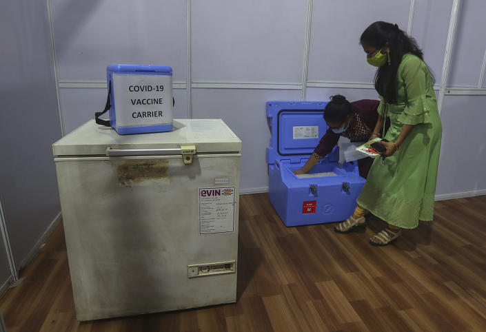 FILE - In this Thursday, Jan.7, 2021, file photo, health workers prepare for a trial run of COVID-19 vaccine, before preparing to roll-out an inoculation program to stem the coronavirus pandemic, in Mumbai, India.India took a regulatory shortcut for their homegrown vaccine, a move touted by Prime Minister Narendra Modi as a success in India's self-reliance. But several groups and unions representing scientists and doctors have expressed their concerns over scant evidence of effectiveness for the vaccine by Indian drugmaker Bharat Biotech. Many scientists have said that approving a vaccine without evidence from late trials is risky and a lack of transparency in the approval process could increase vaccine hesitancy in the world's second-most populated country, where more than 10.4 million coronavirus cases have been reported among the nearly 1.4 billion people. (AP Photo/Rafiq Maqbool, File)