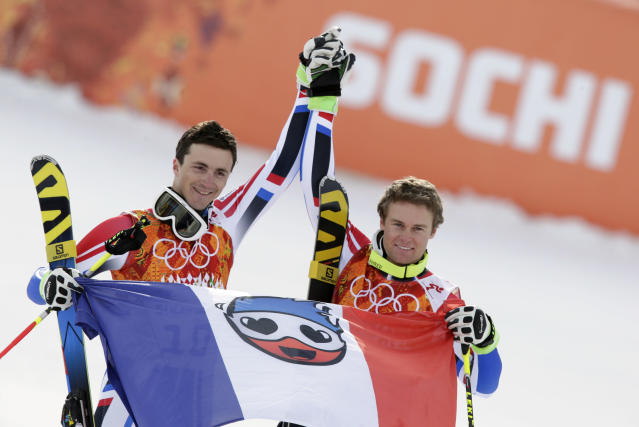 Men's giant slalom medalists from France Steve Missillier (silver), left, and Alexis Pinturault (bronze), pose for photographers at the Sochi 2014 Winter Olympics, Wednesday, Feb. 19, 2014, in Krasnaya Polyana, Russia. (AP Photo/Gero Breloer)