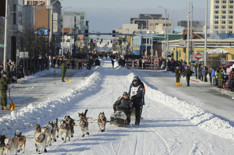FILE - In this March 2, 2019, file photo, defending champion Joar Lefseth Ulsom runs his team down Fourth Ave during the ceremonial start of the Iditarod Trail Sled Dog Race in Anchorage, Alaska. Alaska Airlines announced Monday, March 2, 2020, it will drop its sponsorship of the Iditarod, Alaska's most famous sporting event. The airline in a statement said the decision was made as it transitions to a new corporate giving strategy, but People for the Ethical Treatment of Animals, the most vocal critic of the thousand-mile sled dog race across Alaska, immediately took credit. (AP Photo/Michael Dinneen, File)
