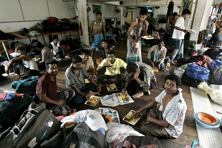 Bangladeshi migrant workers enjoy a charity meal at the Bangladeshi High Commission in Kuala Lumpur on 25 December 2007