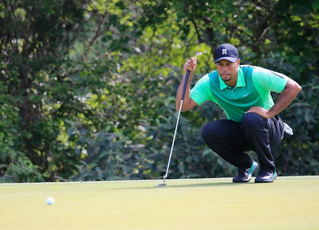 Tiger Woods opens with a 3-over 74 at the Quicken Loans National