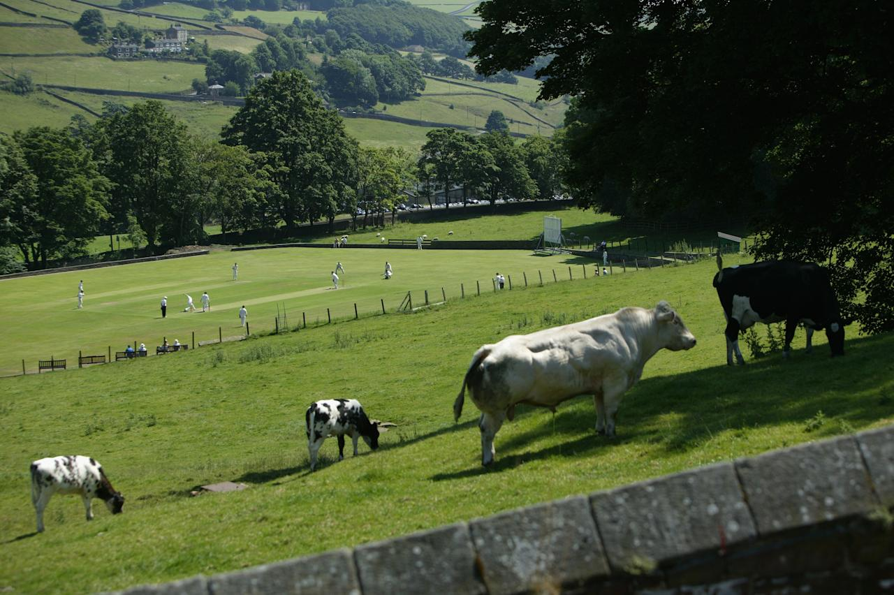 BOOTH, ENGLAND - JULY 09:  A general view  of a village cricket match at Booth Cricket Club on July 09, 2005 in Booth, England.  (Photo by Laurence Griffiths/Getty Images)