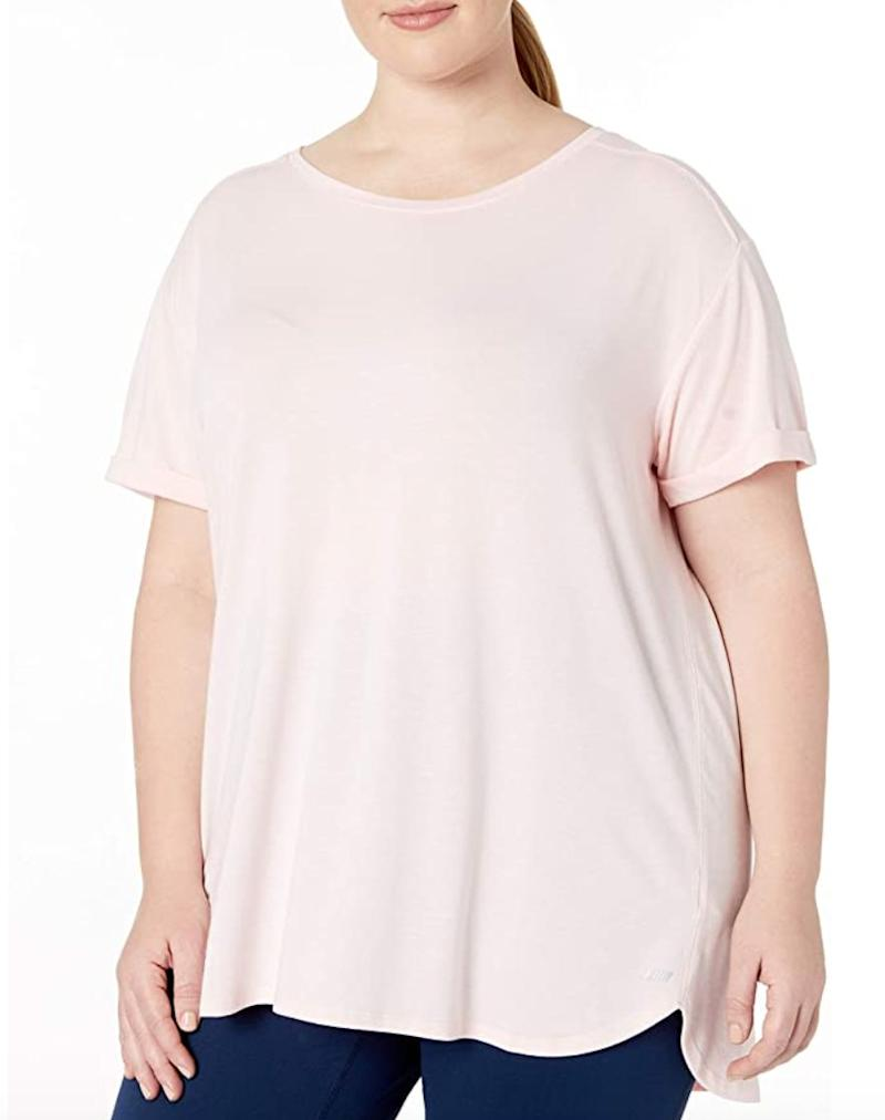 """This<a href=""""https://amzn.to/33Xkdiz"""" target=""""_blank"""" rel=""""noopener noreferrer"""">athleisure top from Amazon Essentials</a>has a relaxed fit that you can move in, with a crew neck, dropped shoulder and rounded hemline. It's made of polyester, rayon and elastane and can be machine washed.<br /><br /><strong>Sizes:</strong> This top comes in sizes 1X to 6X.<br /><strong>Rating:</strong> It has a 4.4-star rating over more than 100 reviews.<br /><strong>$$$:</strong> <a href=""""https://amzn.to/33Xkdiz"""" target=""""_blank"""" rel=""""noopener noreferrer"""">Find it starting at $14 on Amazon</a>."""