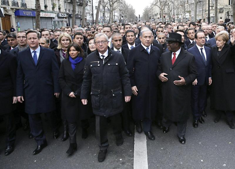 French President Francois Hollande (2-R) is surrounded by heads of state including Britain's PM David Cameron (L), Israel's PM Benjamin Netanyahu (4-R) and Germany's Chancellor Angela Merkel (R) at a solidarity march in Paris on January 11, 2015