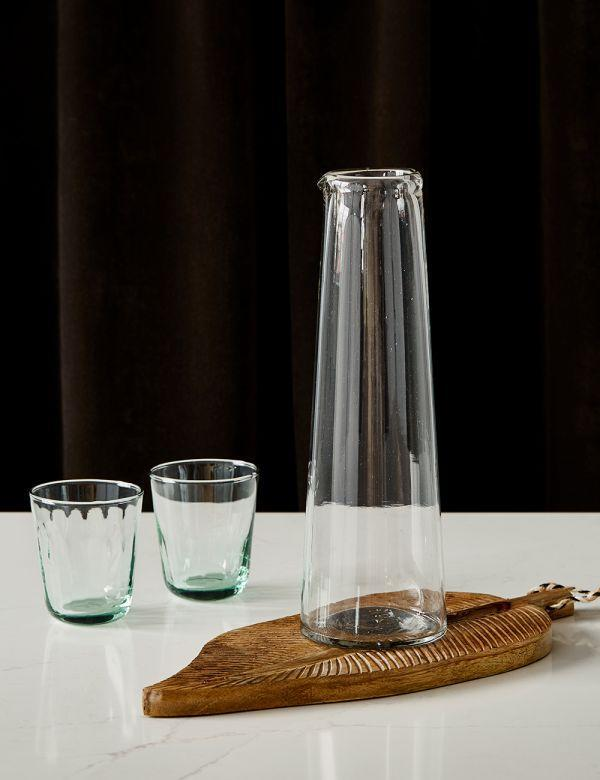 """<strong>Anna Jay, Art Director</strong><br><br>Who doesn't love a carafe of wine? Close your eyes and it'll feel like being in a Greek taverna.<br><br><strong>Rose & Grey</strong> Recycled Glass Wine Carafe, $, available at <a href=""""https://www.roseandgrey.co.uk/recycled-glass-wine-carafe"""" rel=""""nofollow noopener"""" target=""""_blank"""" data-ylk=""""slk:Rose & Grey"""" class=""""link rapid-noclick-resp"""">Rose & Grey</a>"""