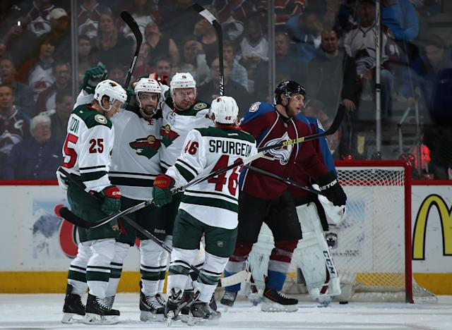 DENVER, CO - APRIL 26: Matt Moulson #26 of the Minnesota Wild celebrates his goal against the Colorado Avalanche to tie the score 1-1 in the second period with Jonas Brodin #25, Dany Heatley #15 and Jared Spurgeon #46 of the Minnesota Wild in Game Five of the First Round of the 2014 NHL Stanley Cup Playoffs at Pepsi Center on April 26, 2014 in Denver, Colorado. (Photo by Doug Pensinger/Getty Images)