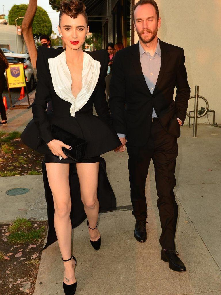 To the nines: Lily Collins and her boyfriend, filmmaker Charlie McDowell, arriving at a Cartier event