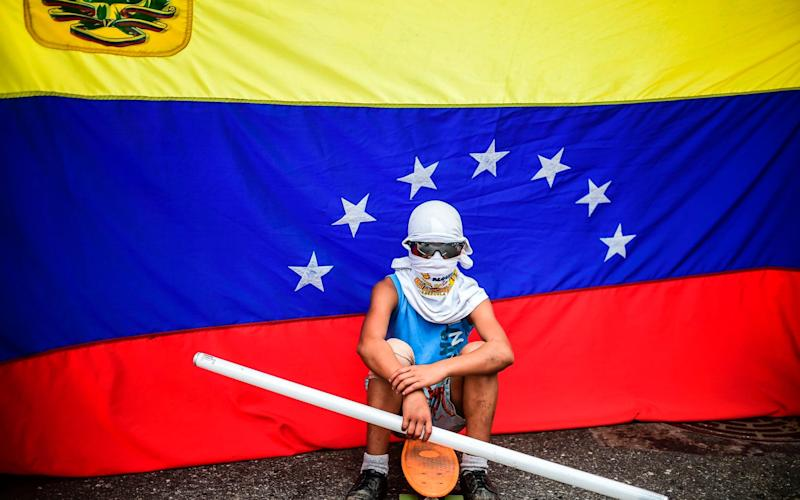 An opposition activist stands by during a protest against the newly inaugurated Constituent Assembly in Caracas - AFP