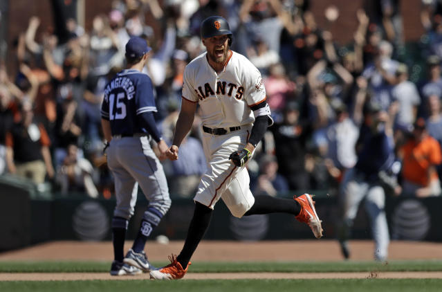 San Francisco Giants' Hunter Pence, center, celebrates after his bases-loaded walk-off double against the San Diego Padres during the eleventh inning of a baseball game Sunday, June 24, 2018, in San Francisco. San Francisco won 3-2. (AP Photo/Marcio Jose Sanchez)