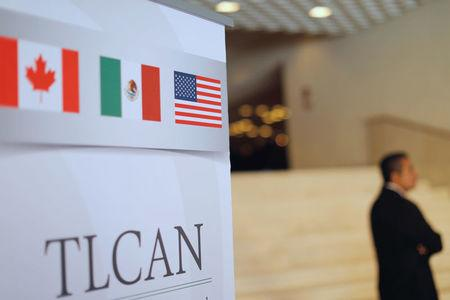 A NAFTA banner is seen during the fifth round of NAFTA talks involving the United States, Mexico and Canada, in Mexico City, Mexico November 17, 2017. REUTERS/Carlos Jasso