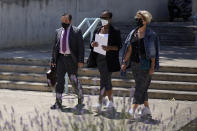 """Lawyer Javier Villalba, left and John McAfee's wife Janice, centre, enter the Brians 2 penitentiary center with an unidentified woman in Sant Esteve Sesrovires, near Barcelona, northeast Spain, Friday, June 25, 2021. A judge in northeastern Spain has ordered an autopsy for John McAfee, creator of the McAfee antivirus software, a gun-loving antivirus pioneer, cryptocurrency promoter and occasional politician who died in a cell pending extradition to the United States for allegedly evading millions in unpaid taxes. McAfee's Spanish lawyer, Javier Villalba, said the entrepreneur's death had come as a surprise to his wife and other relatives, since McAfee """"had not said goodbye."""" (AP Photo/Joan Mateu)"""
