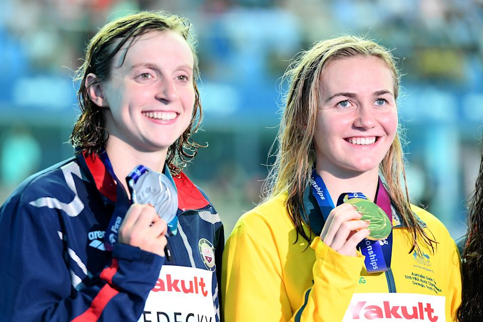 GWANGJU, SOUTH KOREA - JULY 21: (L-R) Silver medalist Katie Ledecky of the United States and gold medalist Ariarne Titmus of Australia pose during the medal ceremony for the Women's 400m Freestyle Final on day one of the Gwangju 2019 FINA World Championships at Nambu International Aquatics Centre on July 21, 2019 in Gwangju, South Korea. (Photo by Quinn Rooney/Getty Images)