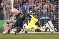 Philadelphia Union forward Sergio Santos, center, shot goes past Toronto FC goalkeeper Alex Bono, right, for a goal during the first half of an MLS soccer match, Wednesday, Aug. 4, 2021, in Chester, Pa. (AP Photo/Christopher Szagola)
