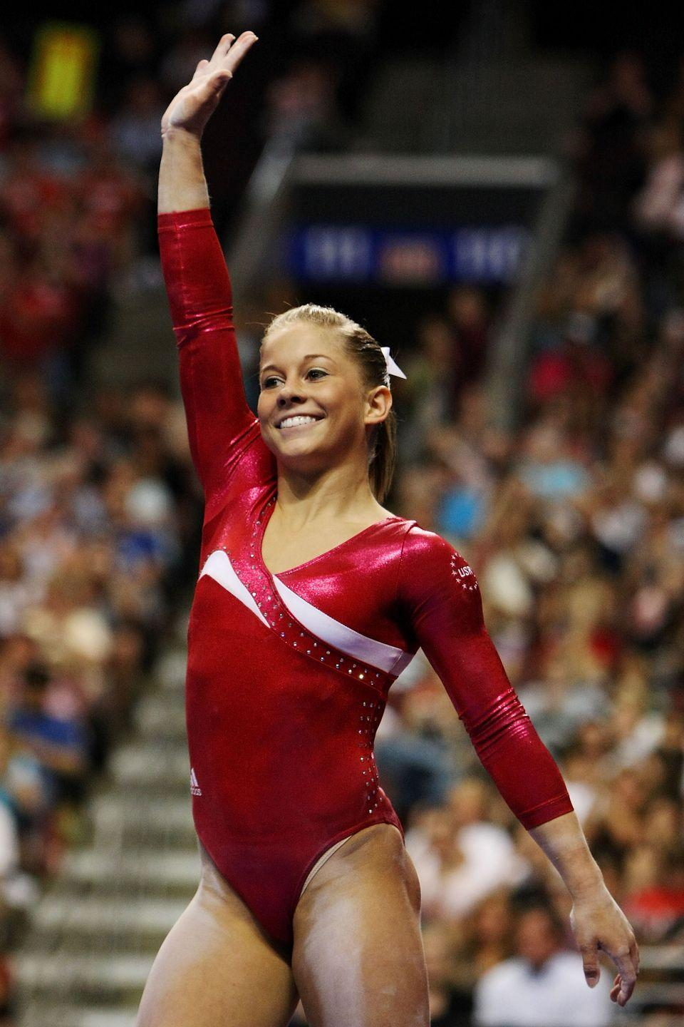 """<p>Shawn Johnson became one of the world's most popular gymnasts after her debut at the 2008 Olympic Games in Beijing. During the competition, the 4'11"""" athlete took home four Olympic medals—but it was her gregarious personality that won over the crowds. </p>"""