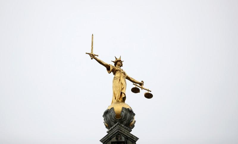 Statue of Lady Justice is seen at Old Bailey central criminal court in London