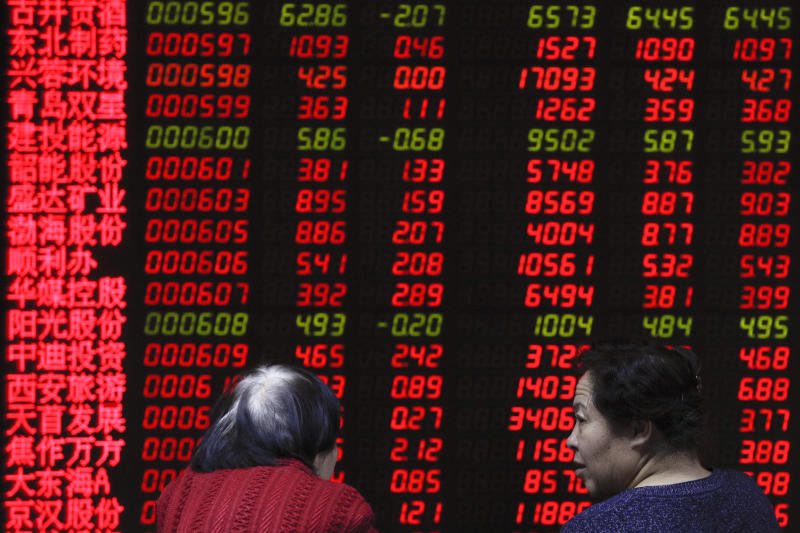 Women chat as they monitor stock prices at a brokerage house in Beijing, Friday, Feb. 1, 2019. Asian markets were mixed on Friday as trade talks ended in Washington with no deal but the promise of a second meeting between U.S. President Donald Trump and Chinese leader Xi Jinping. Gains were limited by a private survey showing that Chinese manufacturing slowed to the lowest level in almost three years. (AP Photo/Andy Wong)