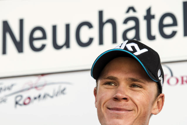 Britain's winner Christopher Froome of team Sky Procycling smiles on the podium after the 5th and last stage, a 18,5 km race against the clock, at the 68th Tour de Romandie UCI ProTour cycling race, in the Stadium Maladiere in Neuchatel, Switzerland, Sunday, May 4, 2014. (AP Photo/Keystone, Jean-Christophe Bott)