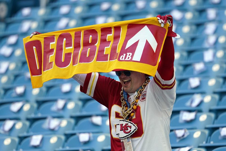 A Kansas City Chiefs fan watches before the NFL Super Bowl 54 football game between the Chiefs and the San Francisco 49ers, Sunday, Feb. 2, 2020, in Miami. (AP Photo/David J. Phillip)