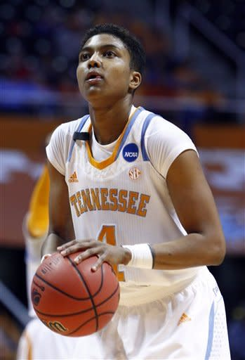 Tennessee guard Kamiko Williams (4) shoots a free throw in the second half of a second-round game in the women's NCAA college basketball tournament against Creighton on Monday, March 25, 2013, in Knoxville, Tenn. Tennessee won 68-52 to advance. (AP Photo/Wade Payne)