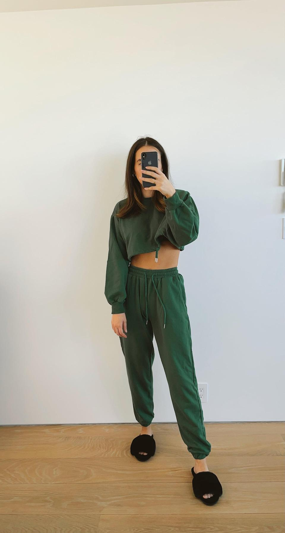 <p>I first fell in love with this dark green <span>Aoxjox Two-Piece Sweat Set</span> ($38) because of the color, but after I tried it on, I knew it was going to become one of my favorite outfits to wear on repeat. The pants are high waisted (just how I like them) and the sweatshirt sleeves are on the longer side, which I absolutely love. Not only that, but it looks way more expensive than its $38 price tag. </p>