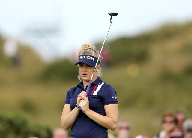 England's Charley Hull reacts after a putt on the 9th green during the third day of the Women's British Open golf championship on the Royal Birkdale Golf Club in Southport, England, Saturday, July 12, 2014. (AP Photo/Scott Heppell)