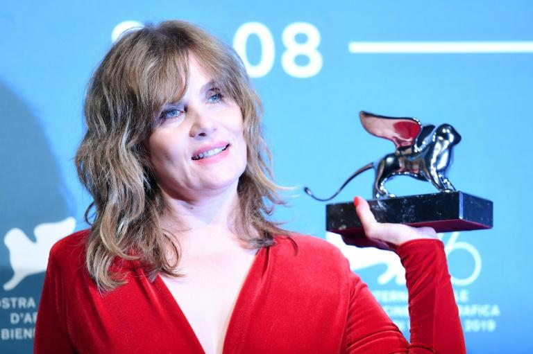 POlanski's wife, French actress Emmanuelle Seigner, picked up his award for him (AFP Photo/Alberto PIZZOLI)