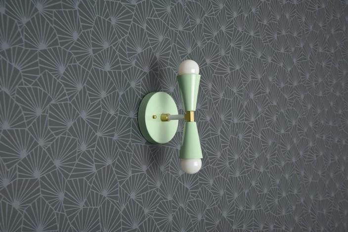 """$108, Etsy. <a href=""""https://www.etsy.com/listing/497434260/modern-wall-sconce-mint-green-sconce?ga_order=most_relevant&ga_search_type=all&ga_view_type=gallery&ga_search_query=sconce&ref=sc_gallery-2-5&plkey=43738af16a6947bca8a5e75521e1fad28ee0b727%3A497434260&frs=1"""" rel=""""nofollow noopener"""" target=""""_blank"""" data-ylk=""""slk:Get it now!"""" class=""""link rapid-noclick-resp"""">Get it now!</a>"""
