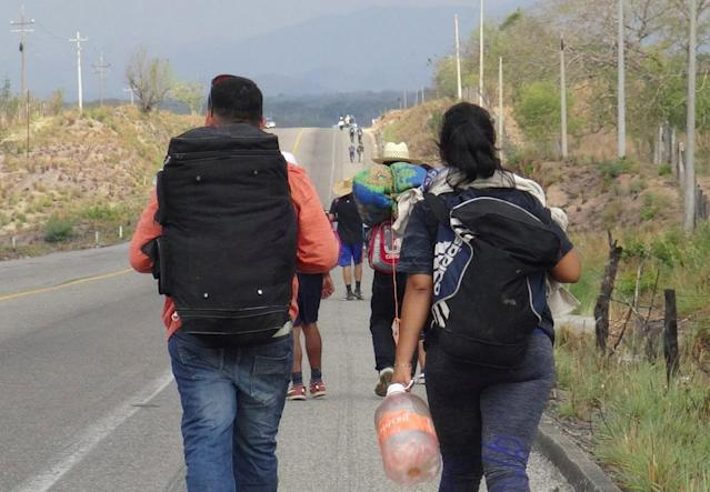 <p>Central American migrants arrive at in Ixtepec, Oaxaca, Mexico, before continuing their journey to the U.S. despite U.S. President Donald Trump's vow to stamp out illegal immigration, March 30, 2018. (Photo: Jose Jesus Cortes/Reuters) </p>