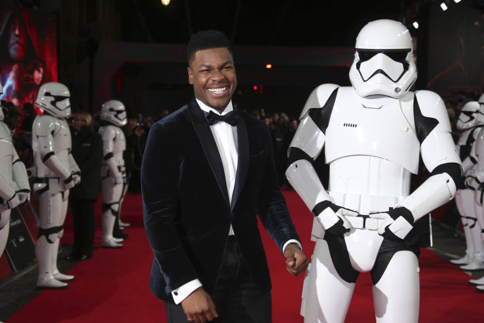 John Boyega poses for photographers upon arrival at the premiere of the film 'Star Wars: The Last Jedi' in London, Tuesday, Dec. 12th, 2017. (Photo by Joel C Ryan/Invision/AP)