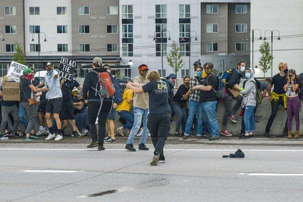 PHOTO: A man shoots at a Jeep speeding through a crowd of people protesting the death of Elijah McClain on I-225 on July 25, 2020 in Aurora, Colorado. (Michael Ciaglo/Getty Images)