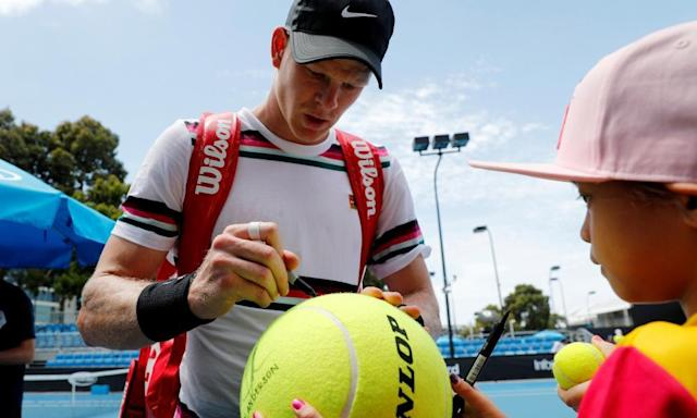 """<span class=""""element-image__caption"""">Kyle Edmund signs an autograph for a young fan after practicing at Melbourne Park on Saturday.</span> <span class=""""element-image__credit"""">Photograph: Kim Kyung-Hoon/Reuters</span>"""
