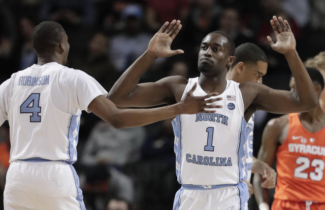 North Carolina forward Theo Pinson (1) high-fives guard Brandon Robinson (4). (AP Photo/Julie Jacobson)