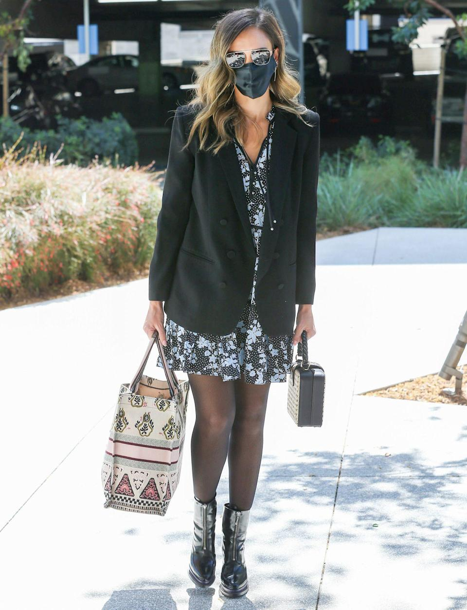 <p>A masked up Jessica Alba enjoys a Wednesday shopping trip in L.A.</p>