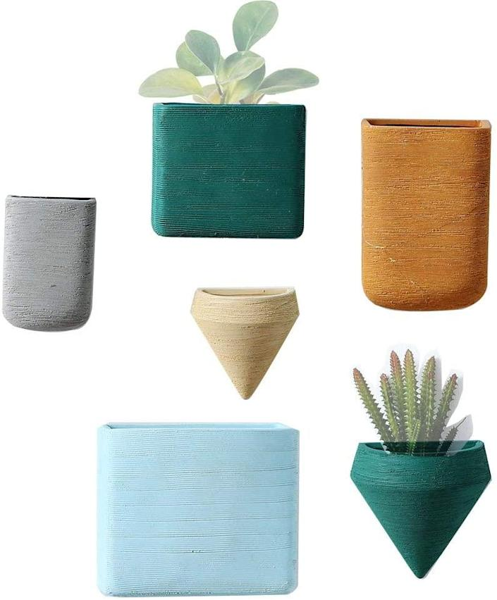 "Wall planters? More like wall art. This versatile, coordinated set of wall planters will infuse your space with tranquil bohemian vibes. $55, Amazon. <a href=""https://www.amazon.com/Planters-Ceramic-Hanging-Geometric-Container/dp/B07JJTQMG9/ref=sr_1_8"" rel=""nofollow noopener"" target=""_blank"" data-ylk=""slk:Get it now!"" class=""link rapid-noclick-resp"">Get it now!</a>"