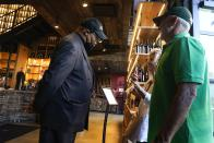 Security personnel ask customers for proof of vaccination as they enter City Winery, Thursday, June 24, 2021, in New York. Customers wanting to wine, dine and unwind to live music at the City Winery's flagship restaurant in New York must show proof of a COVID-19 vaccination to get in. But that's not required at most other dining establishments in the city. And it's not necessary at other City Winery sites around the U.S. (AP Photo/Frank Franklin II)
