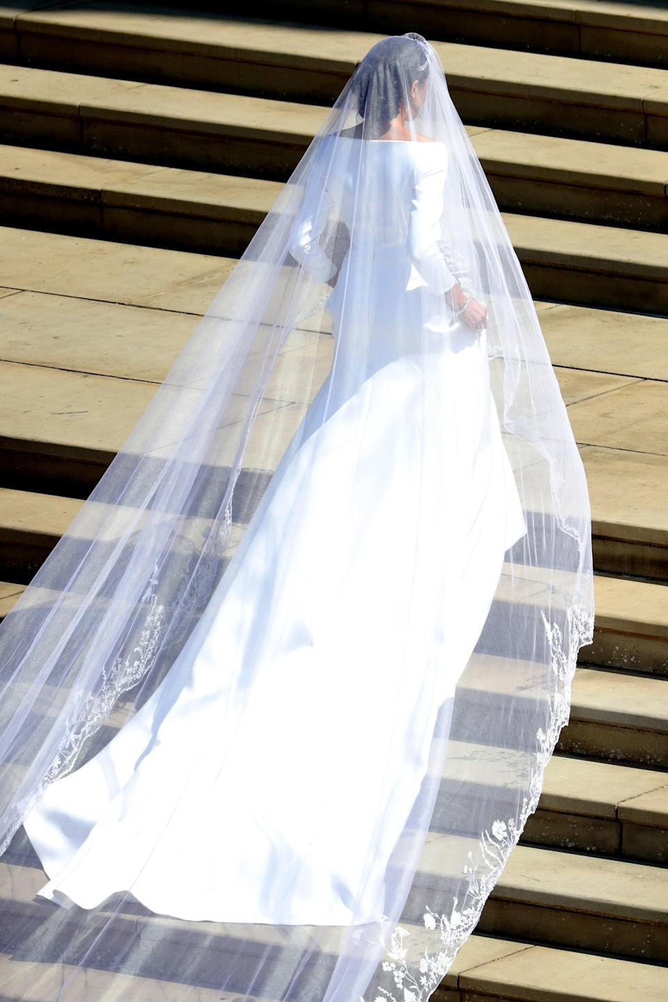 <p>Meghan Markle arrived at St George's Chapel at Windsor Castle for her wedding to Prince Harry wearing a custom dress by Givenchy's artistic director Clare Waight Keller. Boasting a boat neckline, cropped sleeves and a five-foot veil, the dress has been lauded a masterpiece. <em>[Photo: Getty]</em> </p>