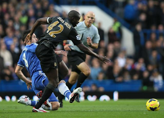 Chelsea's Frank Lampard, left, trips and fouls Manchester City's Yaya Toure during their English Premier League soccer match between Chelsea and Manchester City at Stamford Bridge stadium in London, Sunday, Oct. 27, 2013. (AP Photo/Alastair Grant)