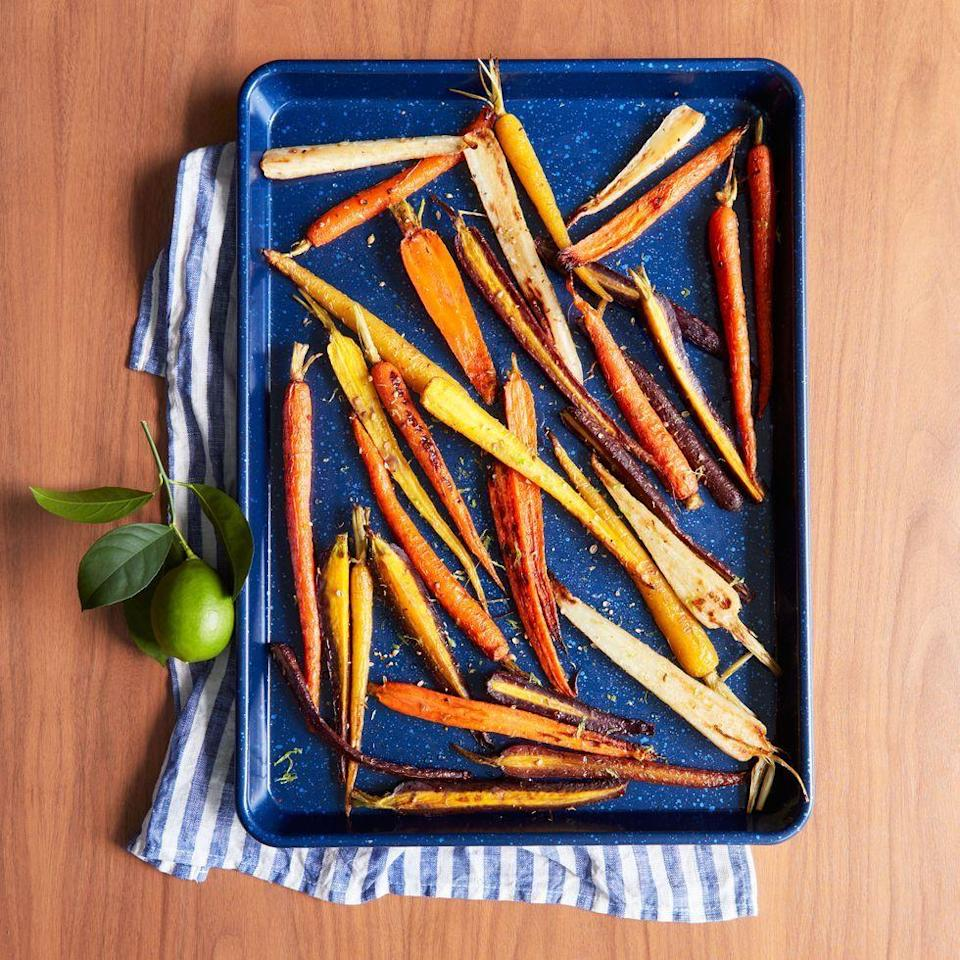 """<p>Rainbow carrots and a squeeze of fresh lime juice make this sweet and spicy side extra bright!</p><p><em><a href=""""https://www.goodhousekeeping.com/food-recipes/a34360792/coriander-maple-glazed-carrots-recipe/"""" rel=""""nofollow noopener"""" target=""""_blank"""" data-ylk=""""slk:Get the recipe for Coriander-Maple Glazed Carrots »"""" class=""""link rapid-noclick-resp"""">Get the recipe for Coriander-Maple Glazed Carrots »</a></em></p>"""