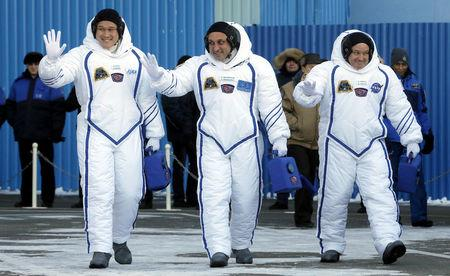 FILE PHOTO: Members of the International Space Station expedition 54/55, Roscosmos cosmonaut Anton Shkaplerov (C), NASA astronaut Scott Tingle (R) and Norishige Kanai (L) of the Japan Aerospace Exploration Agency (JAXA) during the send-off ceremony after checking their space suits before the launch of the Soyuz MS-07 spacecraft at the Baikonur cosmodrome, in Kazakhstan, 17 December 2017.  REUTERS/Maxim Shipenkov/Pool/File Photo