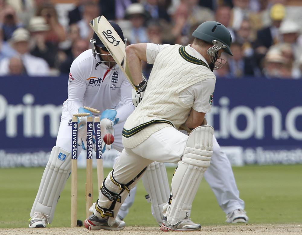 Australia's Chris Rogers is bowled by England's Graeme Swann (not pictured) during play on the fourth day of the second Ashes cricket test match between England and Australia at Lord's cricket ground in north London, on July 21, 2013. AFP PHOTO / IAN KINGTON