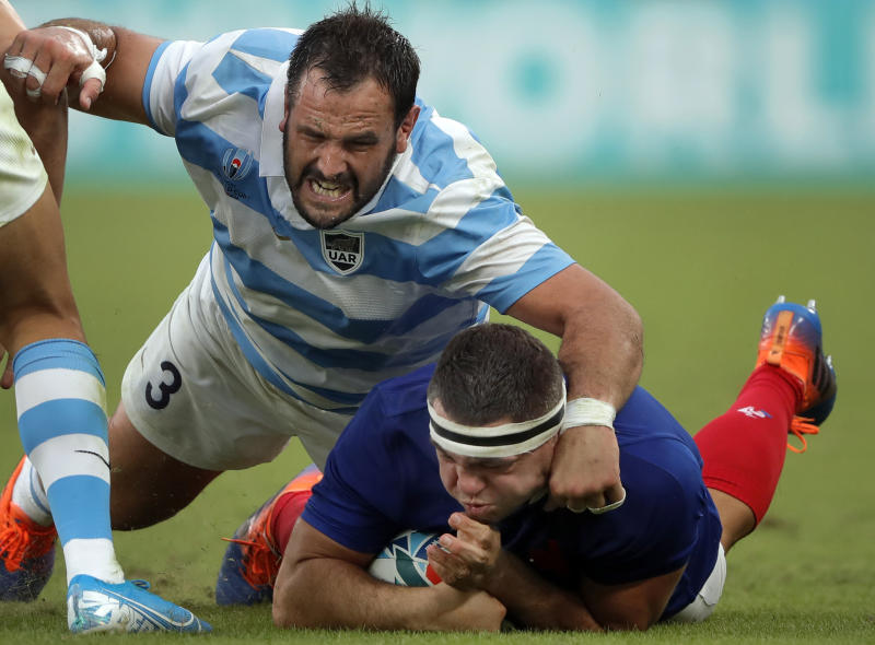 France's Guilhem Guirado, right, is taclked by Argentina's Juan Figallo during the Rugby World Cup Pool C game at Tokyo Stadium between France and Argentina in Tokyo, Japan, Saturday, Sept. 21, 2019. (AP Photo/Christophe Ena)