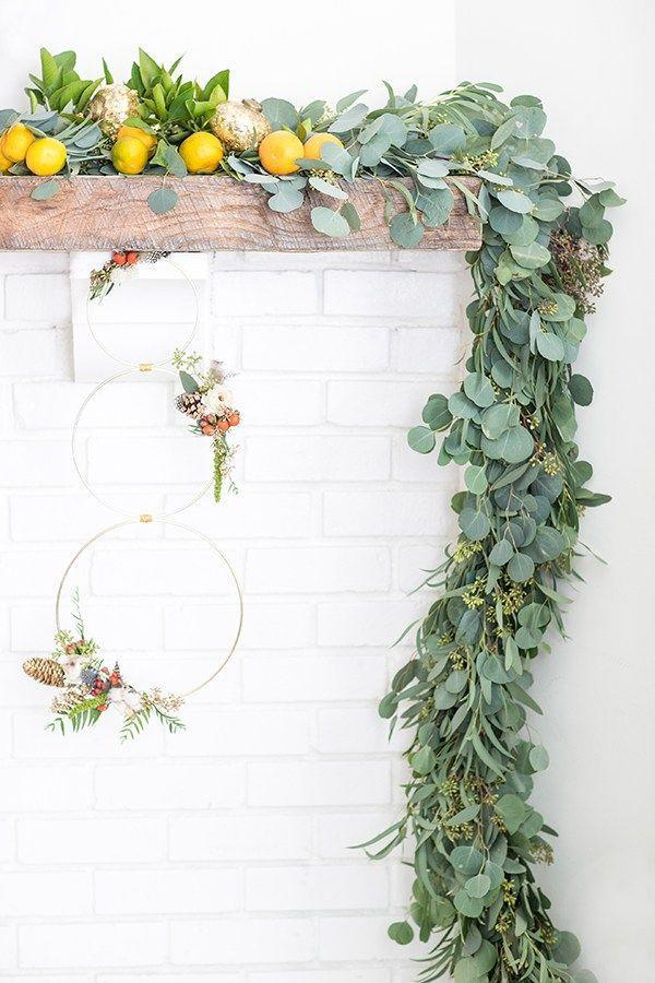 "<p>Dress up your garland by crafting a wreath out of three gold rings. Add in fresh citrus, like lemons or oranges, for extra color.</p><p>Get the tutorial at <a href=""https://sugarandcharm.com/2015/12/modern-christmas-wreath-and-garland.html?section-1"" rel=""nofollow noopener"" target=""_blank"" data-ylk=""slk:Sugar and Charm"" class=""link rapid-noclick-resp"">Sugar and Charm</a>.</p>"